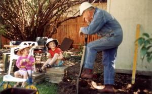 Frank rebuilding a barbecue with grandchildren